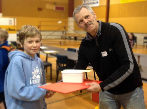 Terry Powell presents Montessori at South End student Samuel Hunter with his chess set prize for winning his age group at the Pahiatua Bush Chess Tournament